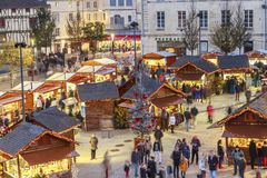 Panoramic view of christmas market at night during the festive period vendors sell from tempora Stock Photography