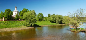 Panoramic view of church over river Stock Photography