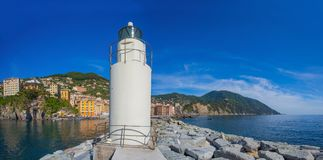 Panoramic view of city of Camogli with the lighthouse, Genoa Province, Liguria, Mediterranean coast, Italy stock photos