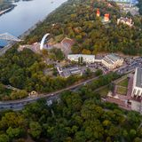 Panoramic view of the city center of Kiev. Aerial view of Arch of Friendship of Peoples, Khreshchaty Park, the main. Panoramic view of a modern city at sunset Royalty Free Stock Image
