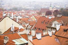 Panoramic view of city center with tiled red roofs, Prague, Czech Republic. Panoramic view of Old town of Prague with stock photo