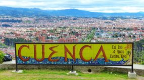 Panoramic view of the city Cuenca, Ecuador. Cuenca, Ecuador.The ceramic sign `Cuenca` by Vega and panoramic view of the city Cuenca from the Turi stock photography