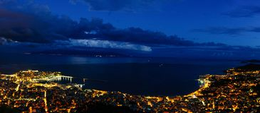 Panoramic view of the city. Heavy clouds cape over city of Kavala, Greece royalty free stock photos