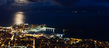 Panoramic view of the city. Heavy cloudscape over city of Kavala, Greece royalty free stock image