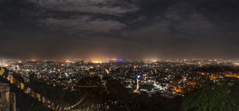 Panoramic view on city of Kathmandu in night-time lighting. Panoramic view from Svayambunath stupa point of view on the infinite city of Kathmandu in drama Royalty Free Stock Image