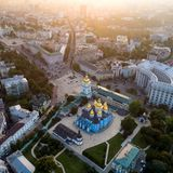 Panoramic view of the city of Kiev. Aerial view of St. Michael`s Golden-Domed Monastery and Sophia Cathedral in the stock images
