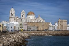 Panoramic view of the city on March, bordered by the Mediterrane. An sea and its Cathedral, called Catedral Nueva by locals, in the background, take in Cadiz Royalty Free Stock Image