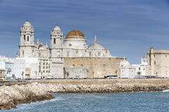 Panoramic view of the city on March, bordered by the Mediterrane. An sea and its Cathedral, called Catedral Nueva by locals, in the background, take in Cadiz Royalty Free Stock Photo