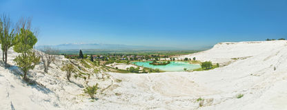 Panoramic view of city and mountains from travertine terraces Stock Images