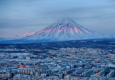 Panoramic view of the city Petropavlovsk-Kamchatsky and volcanoe. S: Koryaksky Volcano, Avacha Volcano, Kozelsky Volcano. Russian Far East, Kamchatka Peninsula Royalty Free Stock Photos