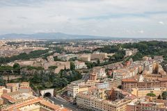 Panoramic view on city of Rome from Papal Basilica of St. Peter. (St. Peter's Basilica). Summer day, people walk on street and cars on road stock images