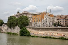 Panoramic view of city Rome with river Tiber and old church on other coast. Summer day and dramatic blue sky stock image
