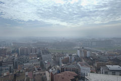 Panoramic view of a city with the sky full of clouds. Stock Photos