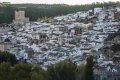 Panoramic view of the city, on top of limestone mountain is situated Castle of the 12TH century Almohad origin, take in. Alcala del Jucar, Spain - October 29 stock photos