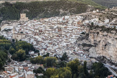Panoramic view of the city, on top of limestone mountain is situated Castle of the 12TH century Almohad origin, take in. Alcala del Jucar, Spain - October 29 royalty free stock image