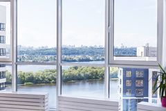 Panoramic view of the city from the windows of the skyscraper. Beautiful view of the river and the city center. Admire the view from the window stock photo
