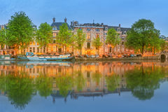 Panoramic view and cityscape of Amsterdam with boats, old buildings and Amstel river, Holland, Netherlands Stock Images