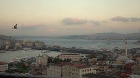 Beautiful marine landscape to Bosphorus strait with ship traffic, Galata bridge and left bank of Istanbul Turkey. Slow stock video