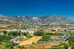 Panoramic View Of Cityscape Of Mijas in Malaga, Andalusia, Spain. Panoramic View Of Mijas in Malaga, Andalusia, Spain. Summer Panorama Cityscape With Motorway Royalty Free Stock Photo