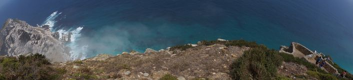 Panoramic view from a cliff with waves. In the background Stock Photography