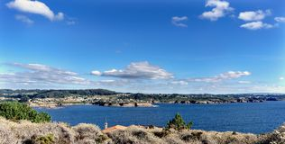 Panoramic view of the cliffs on the coast of La Coruna Bay Gali. Cia on the Spanish Atlantic coast. Blue sky with some clouds and calm sea stock images