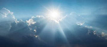 Panoramic view of clouds and sun with beautiful rays against the royalty free stock photos