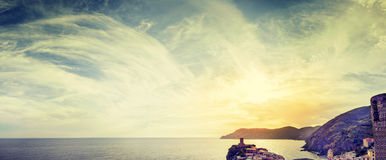 Panoramic view of a cloudy sky and the sea at sunset Stock Image
