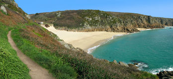 Panoramic view of the coast path to Porthcurno. Royalty Free Stock Photography