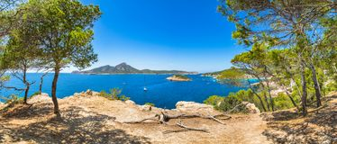Seaside landscape panorama at coast of Sant Elm on Mallorca island, Spain. Panoramic view of coast in Sant Elm with natural landmarks Sa Dragonera and Es Royalty Free Stock Images