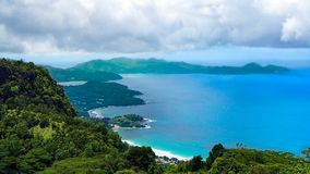 Panoramic view of the coast of Seychelles under cloudy sky stock photo
