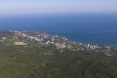 Panoramic view of coastal city. View from a mountain to a coastal city in Crimea, Ukraine Stock Photos