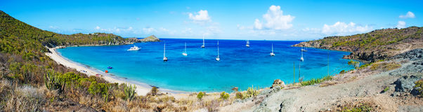 Panoramic view of Colombier beach, cactus, St Barth, sailboats Stock Images