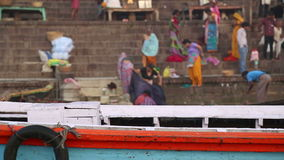 Panoramic view of colorful boat with Varanasi ghat in background. stock video footage