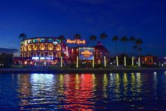 Panoramic view of colorful and illuminated Hard Rock Cafe on blue night background at Universal Studios area. Orlando, Florida. February 05, 2019. Panoramic stock photography