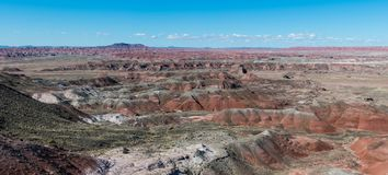 Panoramic view of a vast landscape of a colorful peaks, canyons, and valleys of a desert in the American southwest royalty free stock image