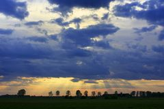 Panoramic view of colorful sunset over wetlands and meadows by the Biebrza river in Poland Royalty Free Stock Images