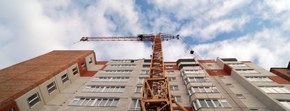 Panoramic view of construction of new modern multi-apartment res. Facade of new multi-apartment high-rise apartment building. Construction of new modern multi stock images
