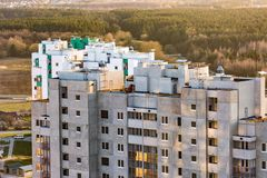 Panoramic view on construction of  new quarter Tower unfinished multi-storey high building from a bird`s eye view with forest on royalty free stock photography