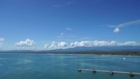 The panoramic view of Costa Rica`s coastline near Limon city from the sea with spectacular clouds.  stock footage