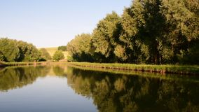 Panoramic view on country landscape. Country pond. Sunny afternoon. Audio footage clip. Sound of birds and insects stock video footage