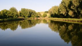 Panoramic view on country landscape. Country pond. Sunny afternoon. Audio footage clip. Sound of birds and insects stock footage