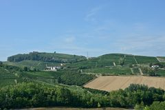 Panoramic view of countryside with vineyard, cultivated fields. On the hills and a blue sky royalty free stock photo