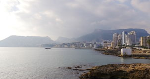 Panoramic view on cozy town calpe 4k sunny day stock video footage