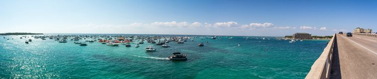Panoramic View of the  Crab Island Park in a Sunny Day with Several Small Boats in the Sea. Taken by the Destin Bridge. Florida royalty free stock photos