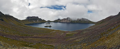 Panoramic view of crater lake active Khangar Volcano. Kamchatka Peninsula Royalty Free Stock Photo