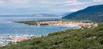 Panoramic view of Cres marina town and mountains Royalty Free Stock Images