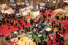 Panoramic view of a crowded indoor exhibition Royalty Free Stock Photos
