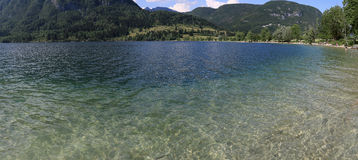 Panoramic view of the crystal clear waters of lake Bohinj a famous destination not far from lake Bled, in Slovenia. Stock Images