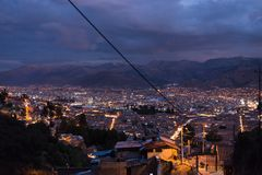 Panoramic view of Cusco town with glowing city lights at dusk. Cusco is among the most touristy travel destination in Peru and Sou Stock Photography