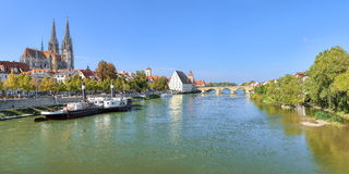 Panoramic view on Danube river with Regensburg Cathedral, Germany. Panoramic view on Danube river in Regensburg with Regensburg Cathedral, Old steamship, Tower Royalty Free Stock Photography